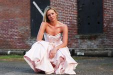 Free Bridesmaid Crouched In Front Of Wall - Horizontal Stock Images - 5283384