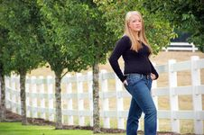 Free Teen Girl Standing Next To A Fence Stock Photos - 5283413