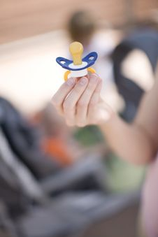 Free Holding Pacifier Royalty Free Stock Photo - 5286865