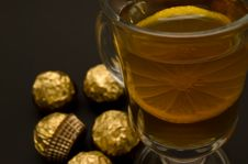 Free Tea With A Lemon In Glass Chake And Candies Stock Photo - 5286880