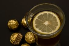 Free Tea With A Lemon In Glass Chake And Candies Royalty Free Stock Images - 5286889
