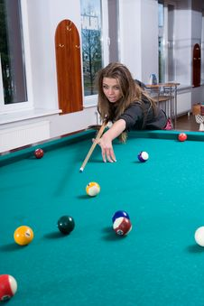 Free Girl In Short Skirt Playing Snooker Stock Photography - 5288292