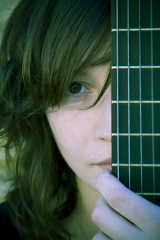 Free Woman Behind Guitar Fretboard Royalty Free Stock Photos - 5288868