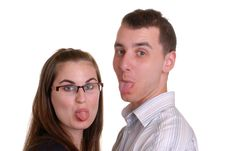 Free Attractive Young Couple Poke Tongues Out Royalty Free Stock Photo - 5291125