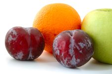 Free Apple, Orange And Plums. Stock Photography - 5295902