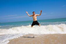 Free Caucasian Hunk Jumping Joyfully At The Beach Royalty Free Stock Image - 5295936