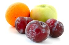Free Apple, Orange And Plums. Royalty Free Stock Photo - 5296015