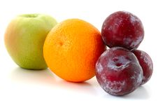 Free Apple, Orange And Plums. Stock Images - 5296324