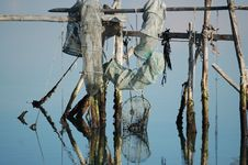 Free Fish Nets On Water With Reflection Royalty Free Stock Photography - 537477