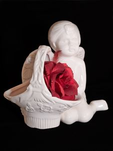 Angel Figure And Red Rose Royalty Free Stock Photography