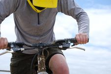 Muddy Mountain Biker Against Blue Sky Royalty Free Stock Images