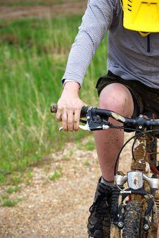 Closeup Mountain Biker On Dirt Road Royalty Free Stock Photography