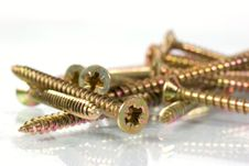 Free Bronze And Nickel Screws Over White Stock Photos - 5304943