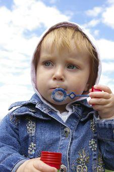 Free Cute Little Girl Making Soap Bubbles Stock Image - 5305381