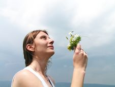 Girl Smelling Wild Flowers Royalty Free Stock Images