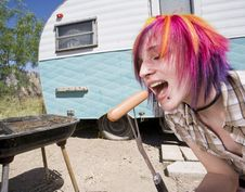 Free Girl In Front Of A Trailer Eating A Hotdog Stock Photos - 5308213