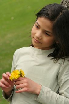 Free Girl Holding Dandelions With Sad Expression Stock Photo - 5309210