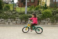 Riding His Bike Royalty Free Stock Image