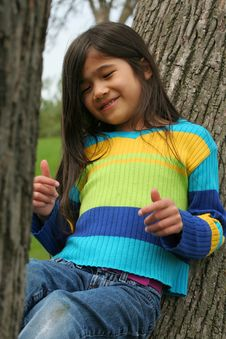Free Adorable Little Girl Sitting Up Against Tree Royalty Free Stock Image - 5310206
