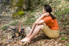 Girl Sitting Near Of Fire On The River Bank Stock Photos