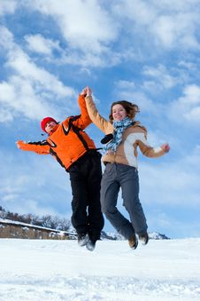 Free Couple Jumping Over Blue Sky Royalty Free Stock Image - 5312556