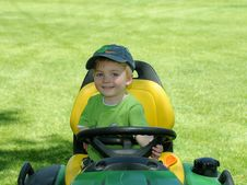 Free Young Child On Riding Lawnmower Stock Photo - 5314310
