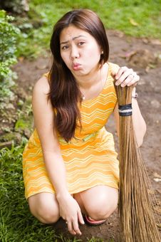 Free Maid Sweeping While Blowing Kiss Stock Photography - 5315432