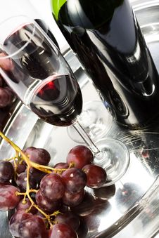 Free Two Glasses Of Red Wine, The Bottle And Grapes Stock Photo - 5318440
