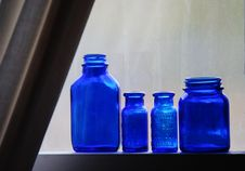 Free Blue Bottles On Window Sill Royalty Free Stock Image - 5318706
