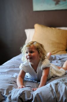 Free Girl Playing On Bed Stock Photo - 5320690
