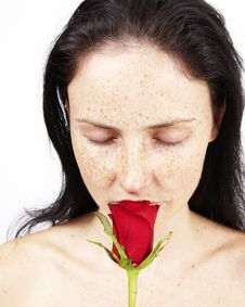 Free Beautiful Brunette Woman With A Rose Stock Photo - 5321860