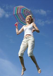 Yong Charming Girl Jumping With Umbrella Stock Photography