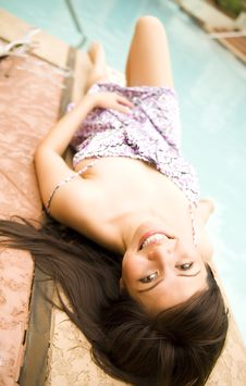 Free Beautiful Girl Laying On Side Of Pool Stock Photo - 5322950