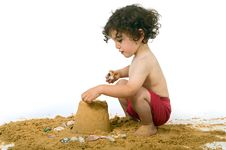 Free Boy Playing In The Sand Royalty Free Stock Image - 5323466