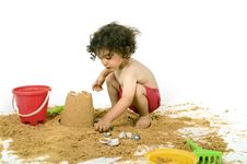 Free Boy Playing In The Sand Stock Photos - 5323583