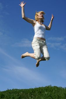 Happy Woman Jump In Field Royalty Free Stock Photos
