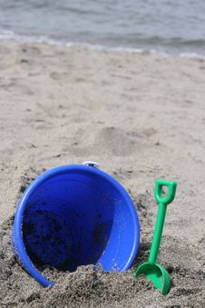 Free Blue Bucket On Beach Sand Stock Images - 5324344