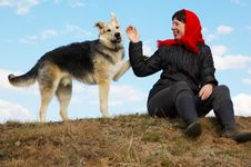 The Woman And Dog Stock Image