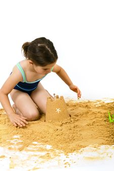 Free Girl Playing In The Sand Stock Photography - 5326052