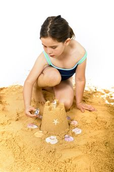 Free Girl Playing In The Sand Royalty Free Stock Photography - 5327717