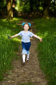Girl Running In Park Royalty Free Stock Images