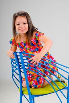 Free Little Girl Sitting On A Chair Royalty Free Stock Image - 5328946