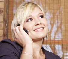 Free Smiling Young Girl Holds Cellphone Stock Image - 5329211
