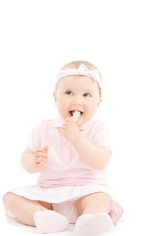 Free Sweet Little Girl Tasting Candy On Stick Royalty Free Stock Photos - 5329838
