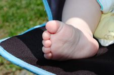 Baby S Foot In Carriage. Stock Images