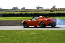 Free Orange Sportscar On The Track Stock Photos - 5336103