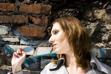 Free Woman Against A Brick Wall Stock Image - 5336351