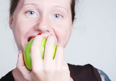 The Girl Biting An Apple Stock Photos