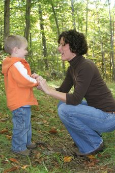Free Mother Dressing Son Stock Photography - 5337402