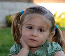 Little Girl With Pony Tails Listening Stock Image